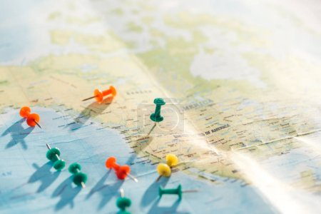 selective focus of world map with colorful push pins