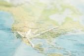 "Постер, картина, фотообои ""Selective focus of cocaine on colorful world map """