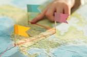 "Постер, картина, фотообои ""Partial view of kid with colorful flags on world map"""