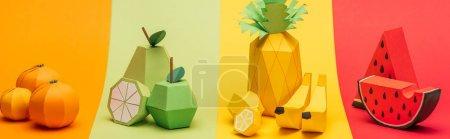 Foto de Panoramic shot of various handmade origami fruits on stripes of colorful paper - Imagen libre de derechos