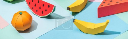 Panoramic shot of handmade cardboard fruits on mul...