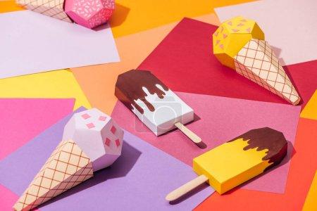 various handmade origami ice cream on multicolored paper