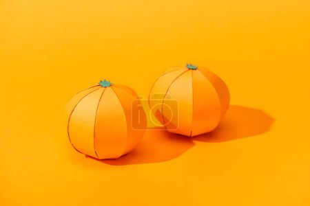 Photo for Handmade tangerines made of paper on orange with shadow - Royalty Free Image