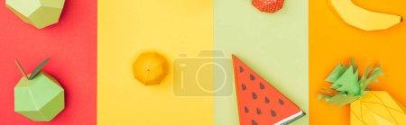 Panoramic shot of various handmade origami fruits ...