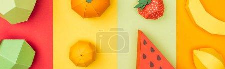 Foto de Panoramic shot of various handmade origami fruits on colorful paper stripes - Imagen libre de derechos