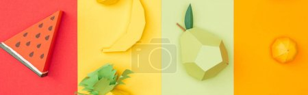 panoramic shot of various handmade origami fruits on colorful paper stripes