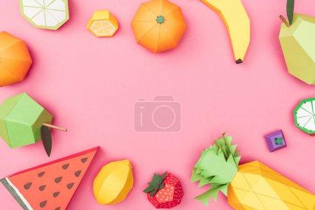 Foto de Top view of handmade colorful origami fruits on pink with copy space - Imagen libre de derechos