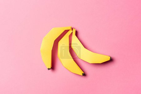 Photo for Top view of yellow paper bananas on pink - Royalty Free Image