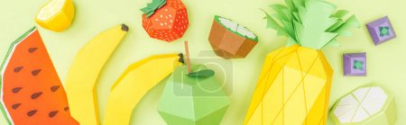 Photo for Panoramic shot of colorful handmade paper fruits isolated on green - Royalty Free Image