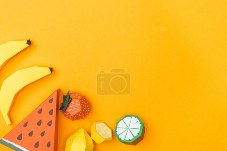 Photo for Top view of various handmade colorful origami fruits isolated on orange with copy space - Royalty Free Image