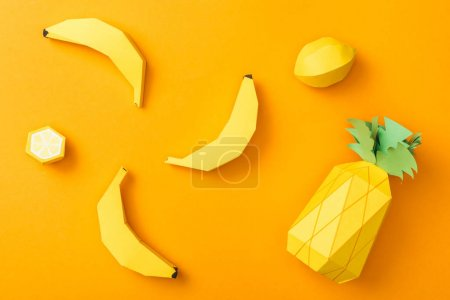 Photo for Top view of handmade paper lemons, bananas and pineapple isolated on orange - Royalty Free Image