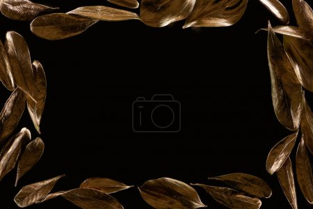 Foto de Top view of frame borders made of golden metal leaves isolated on black with copy space - Imagen libre de derechos