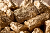 "Постер, картина, фотообои ""close up view of golden textured shiny stones in sunlight"""