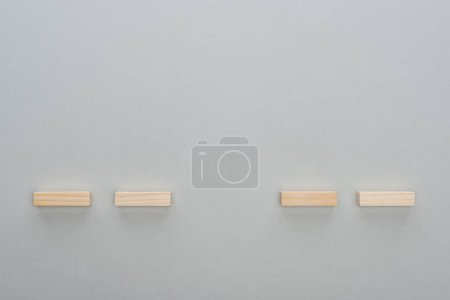 Photo for Top view of wooden blocks isolated on grey with copy space - Royalty Free Image