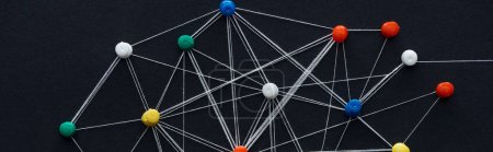 Photo for Panoramic shot of push pins connected with strings isolated on black, network concept - Royalty Free Image