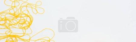 Photo pour Vue supérieure du fil jaune avec l'espace de copie isolated On White - image libre de droit