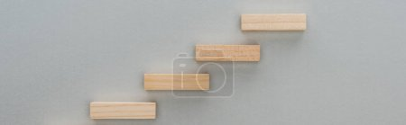 Photo for Panoramic shot of wooden blocks symbolizing career ladder isolated on grey - Royalty Free Image