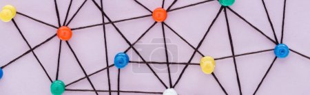 Photo for Panoramic shot of colorful push pins connected with strings Isolated On pink, network concept - Royalty Free Image