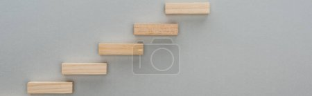 Photo for Panoramic shot of wooden blocks symbolizing career ladder isolated on grey with copy space - Royalty Free Image