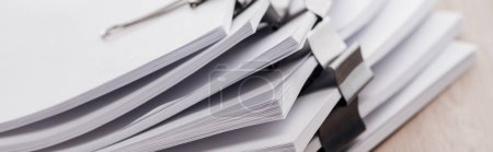 Photo for Panoramic shot of stacks of blank paper with metal paper clips - Royalty Free Image
