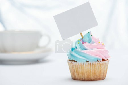 Photo for Selective focus of tasty cupcake decorated with sprinkles and blank card - Royalty Free Image