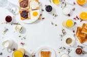 "Постер, картина, фотообои ""top view of plates with tasty breakfast near drinks and oranges on white """