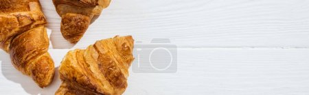Photo for Panoramic shot of tasty croissants on white surface - Royalty Free Image