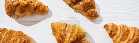 Photo for Panoramic shot of delicious and sweet croissants on white surface - Royalty Free Image