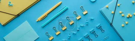 Photo for Panoramic shot of colorful organized stationery isolated on blue - Royalty Free Image