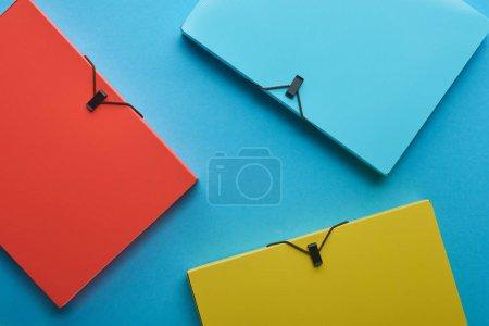 Photo pour Background with multicolored paper binders on blue - image libre de droit