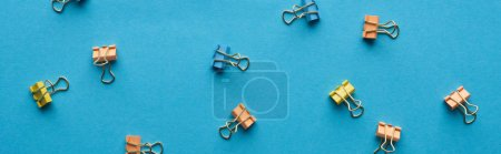 Photo for Panoramic shot of colorful paper clips isolated on blue - Royalty Free Image