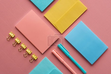 Photo for Background with colorful stationery supplies on pink - Royalty Free Image