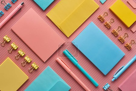 Photo for Top view of colorful stationery supplies on pink - Royalty Free Image