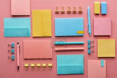 Photo for Flat lay of colorful stationery supplies on pink - Royalty Free Image