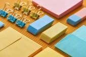 "Постер, картина, фотообои ""close up view of colorful arranged office stationery supplies on yellow"""