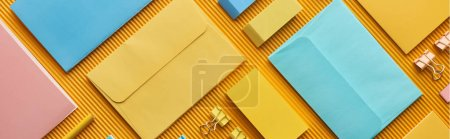 Photo for Panoramic shot of colorful organized office stationery supplies on yellow - Royalty Free Image