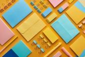 """Постер, картина, фотообои """"flat lay of colorful arranged office stationery supplies on yellow"""""""