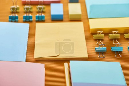 Photo for Selective focus of arranged office stationery supplies on yellow - Royalty Free Image