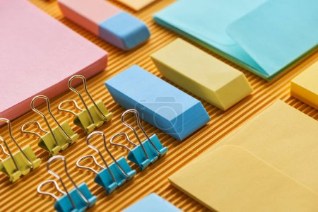 Photo for Close up view of colorful office stationery supplies on yellow - Royalty Free Image