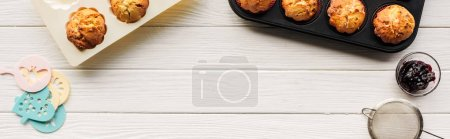 Photo for Top view of delicious cupcakes and baking tools on wooden table with copy space - Royalty Free Image