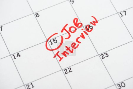 Photo for Print calendar with red mark and job interview lettering - Royalty Free Image