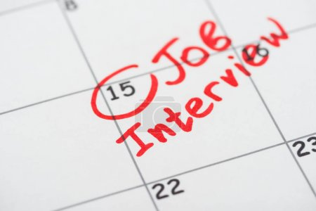 Photo for Close up view of print calendar with red mark and job interview lettering - Royalty Free Image