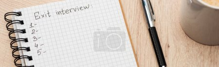 Photo for Panoramic shot of notebook with exit interview lettering and numbers on wooden table near pen and coffee cup - Royalty Free Image