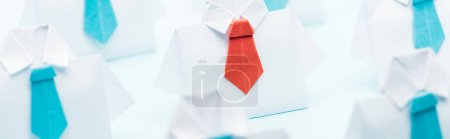 Photo for Panoramic shot of origami white shirts with blue ties with one red, think different concept - Royalty Free Image