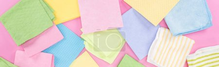 Photo for Panoramic shot of scattered multicolored rags on pink background - Royalty Free Image