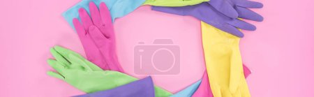 Photo for Panoramic shot of multicolored rubber gloves arranged in circle on pink background - Royalty Free Image