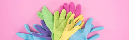Panoramic shot of multicolored rubber gloves in pi...