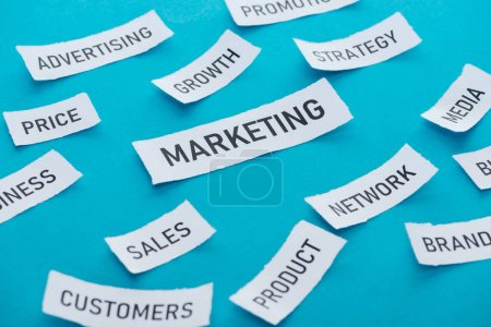 Photo for Marketing components on pieces of paper on blue - Royalty Free Image