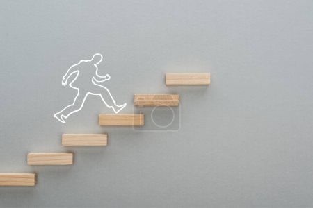 Photo pour Top view of drawn man running on wooden blocks symbolizing career ladder on grey background, business concept - image libre de droit