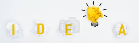 Photo for Panoramic shot of crumpled paper balls, idea word and light bulb illustration on white background, business concept - Royalty Free Image